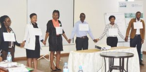 ECAF session in Tanzania; participants demonstrating best practices in agriculture value chain financing