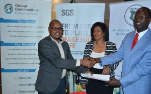 AIMS Program Manager,Ricahrd Muli (left) receiving certificate of participation from FPC CEO,Ojisekere Ojepat(right)